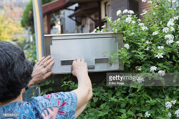 Old Lady Checking Mail Box