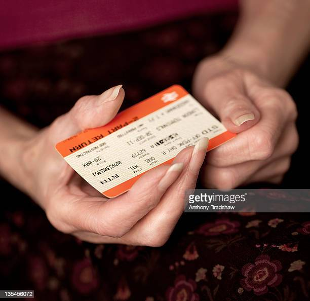 Old lady holding a rail ticket