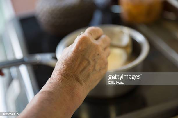 Old Lady Making Breakfast