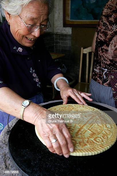 Old lady making Pingyao Style Moon Cake for Moon Festival.