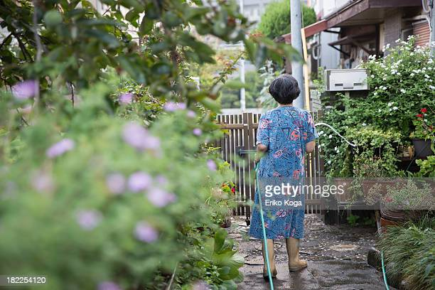 Old Lady Watering Garden