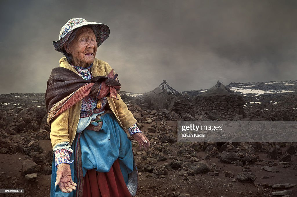 CONTENT] Old lady wearing traditional Colca clothing, intricately embroidered and brightly colored skirts, vest and hat. Many locals speak Quechua as their first language in the Colca Valley, Peru.