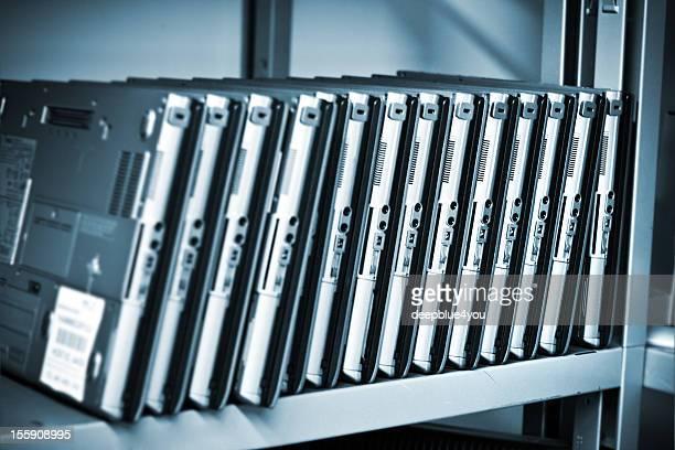 Old laptops in a row in workshop shelf