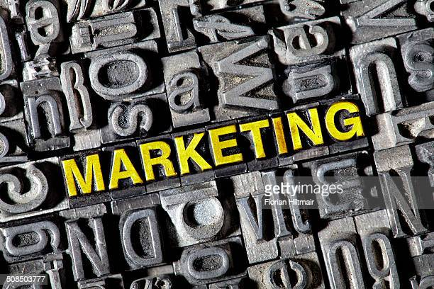 Old lead letters forming the word Marketing