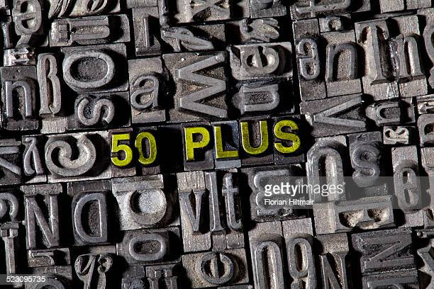 Old lead letters spelling the word 50 PLUS