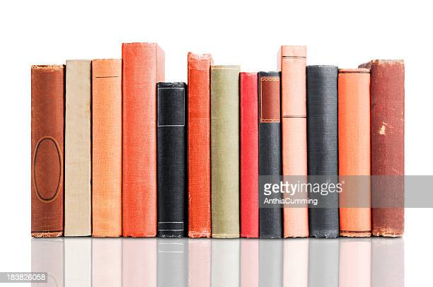 Old leather covered books isolated on white background