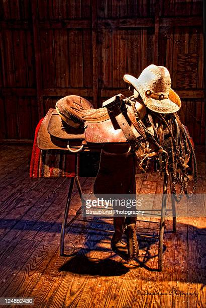Old leather saddle, bridle and cowboy hat