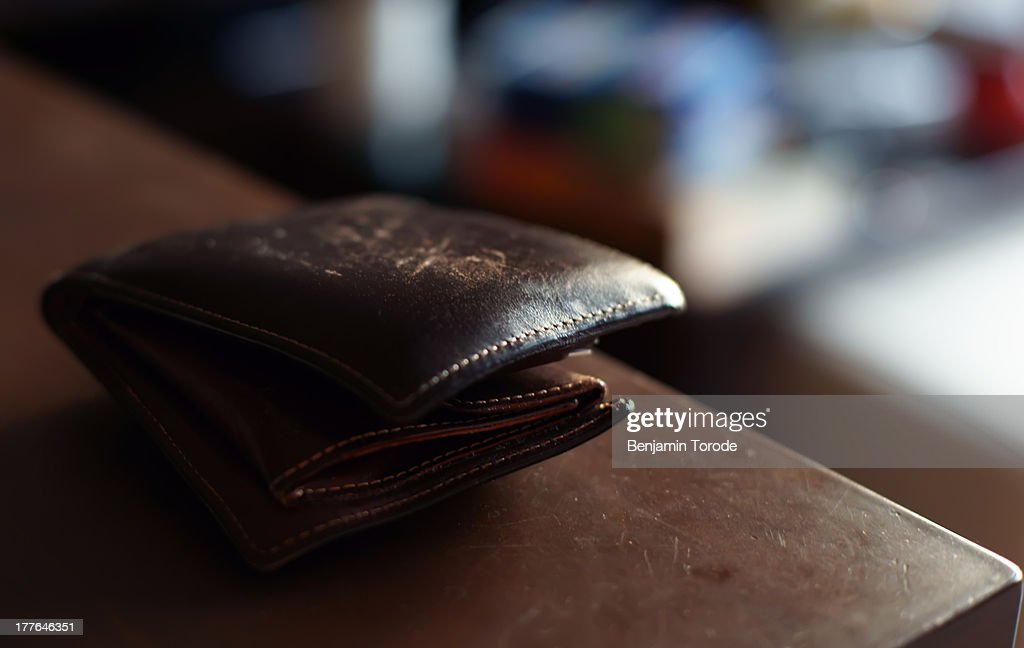 Old leather wallet on table