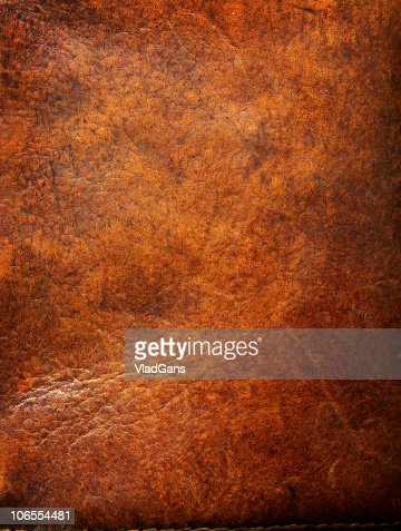 Old leather with tattered eges