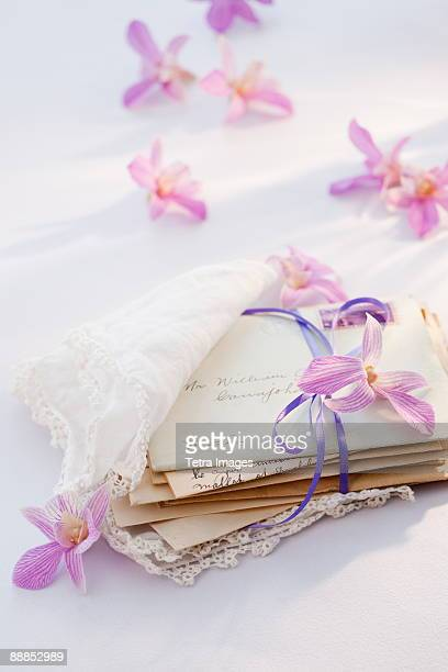 Old letters wrapped in handkerchief with flowers around