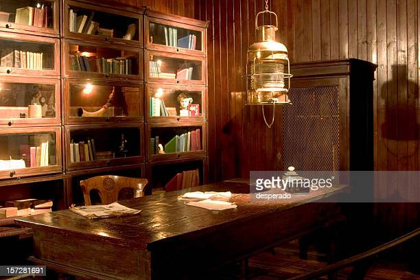 Old library setting with desk and lantern