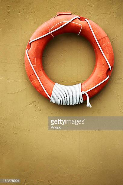 Old lifesaver on a wall