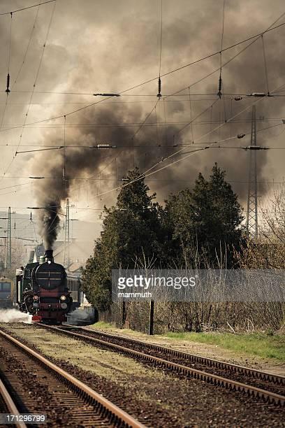 old locomotive leaving the railway station