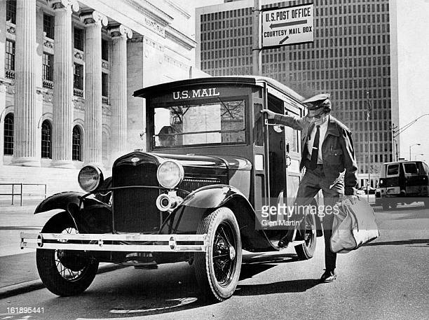 MAY 4 1976 Old Mail Truck Back 'On The Job' Dwayne Cavanar who has been a mailman 'on and off' for the past 30 years steps from the cab of a 1931...