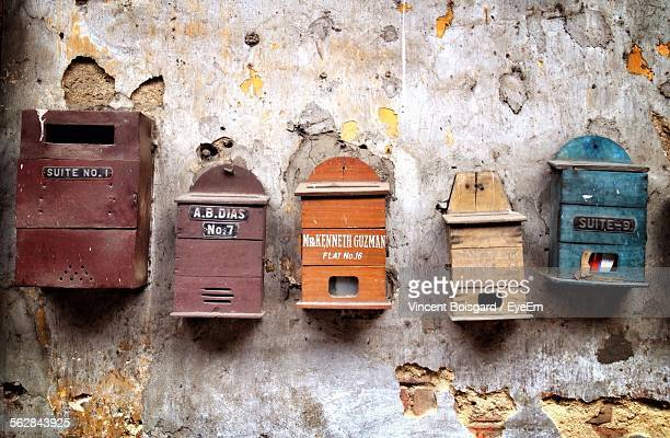 Old Mailboxes At Weathered Wall