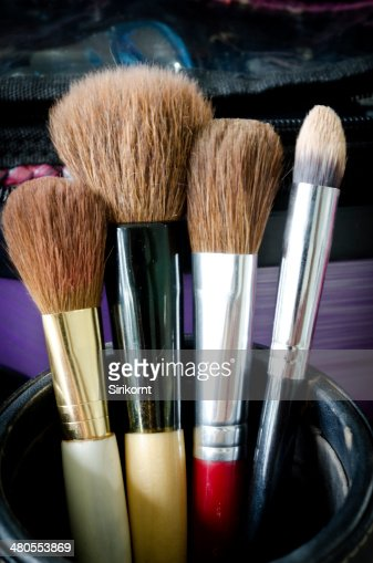 Old makeup brushes in holder : Stock Photo