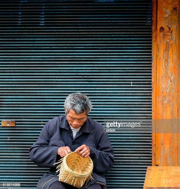 Old man Basket weaving from bamboo, village Zhao Xing.