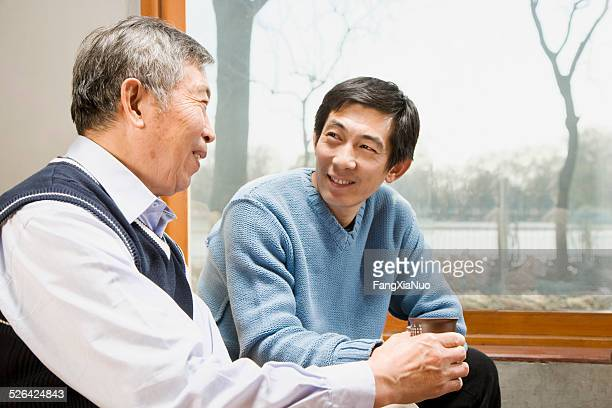 Old Man Chatting with His Son