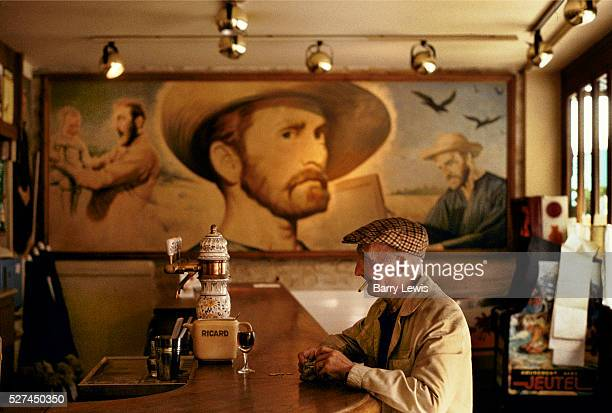 Old man drinking at a bar opposite Van Gogh's house in Auvers sur Oise The mural in the background shows Kirk Douglas playing Van Gogh in the film...