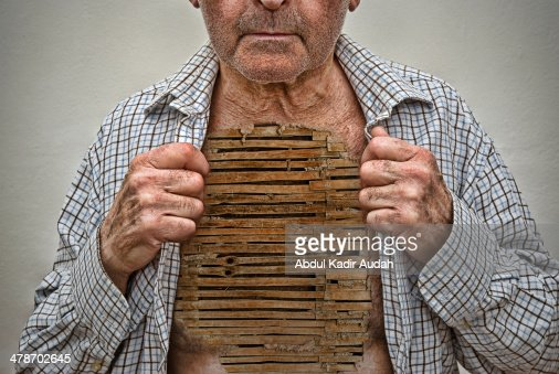 Old man exposing chest of woven wattle