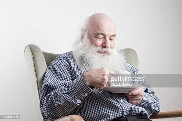 Old Man Having Tea on a Chair