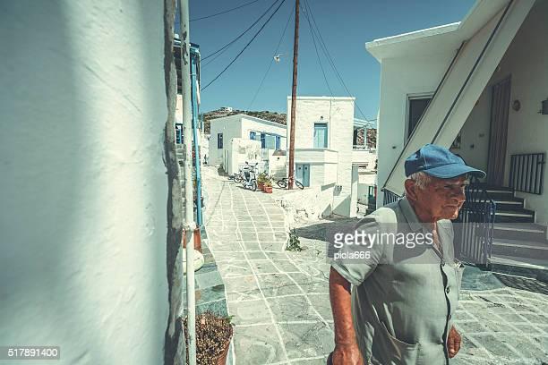 Old man in a street of village on Greek island