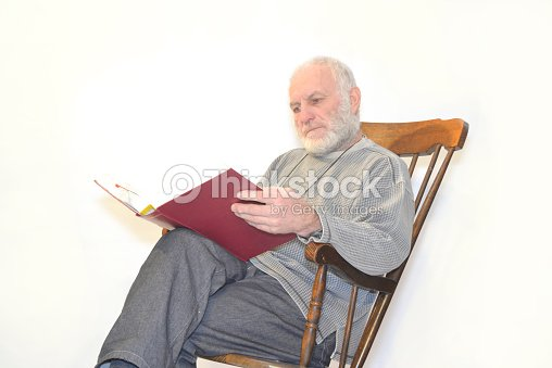 Old Man Is Sitting In Rocking Chair Stock Photo Thinkstock