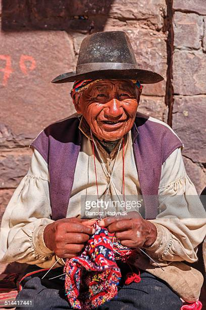 Old man knitting on Taquile Island