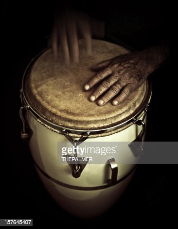 old man playing congas