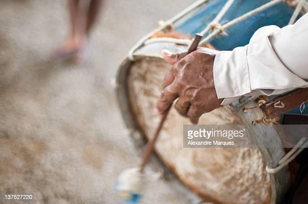 Old man playing drum
