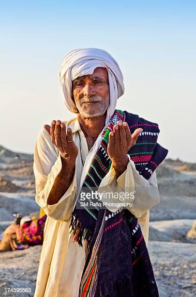 Old man praying to God