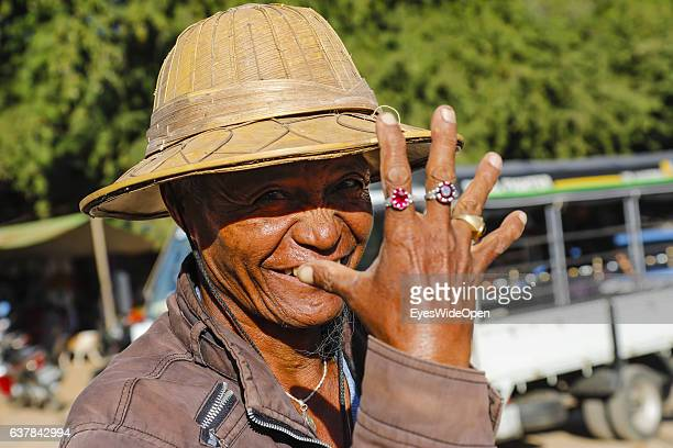 Old man showing his luxury rings with diamants and saphires and visit the historical zone Bagan with thousands of pagodas and temples on December 10...