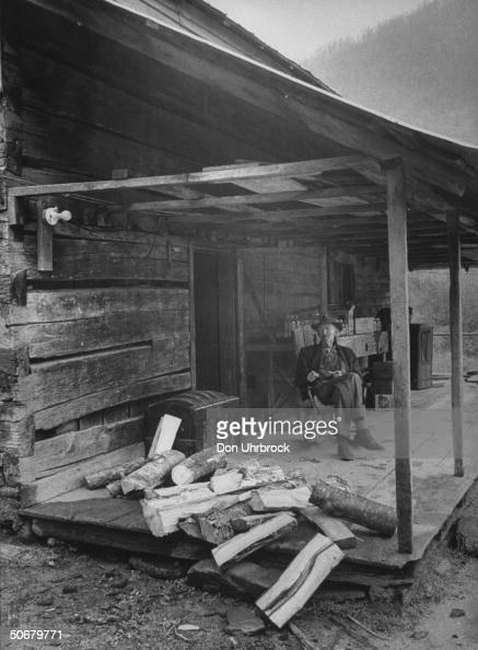 Old Man Sitting In Rocking Chair On His Pictures Getty
