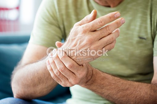 Old man suffering from pain and rheumatism : Stock Photo
