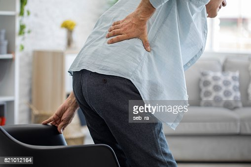 Old man with back pain : Stock Photo