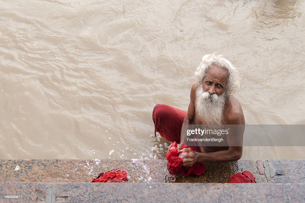 Old man with beard doing his rituals : Stock Photo