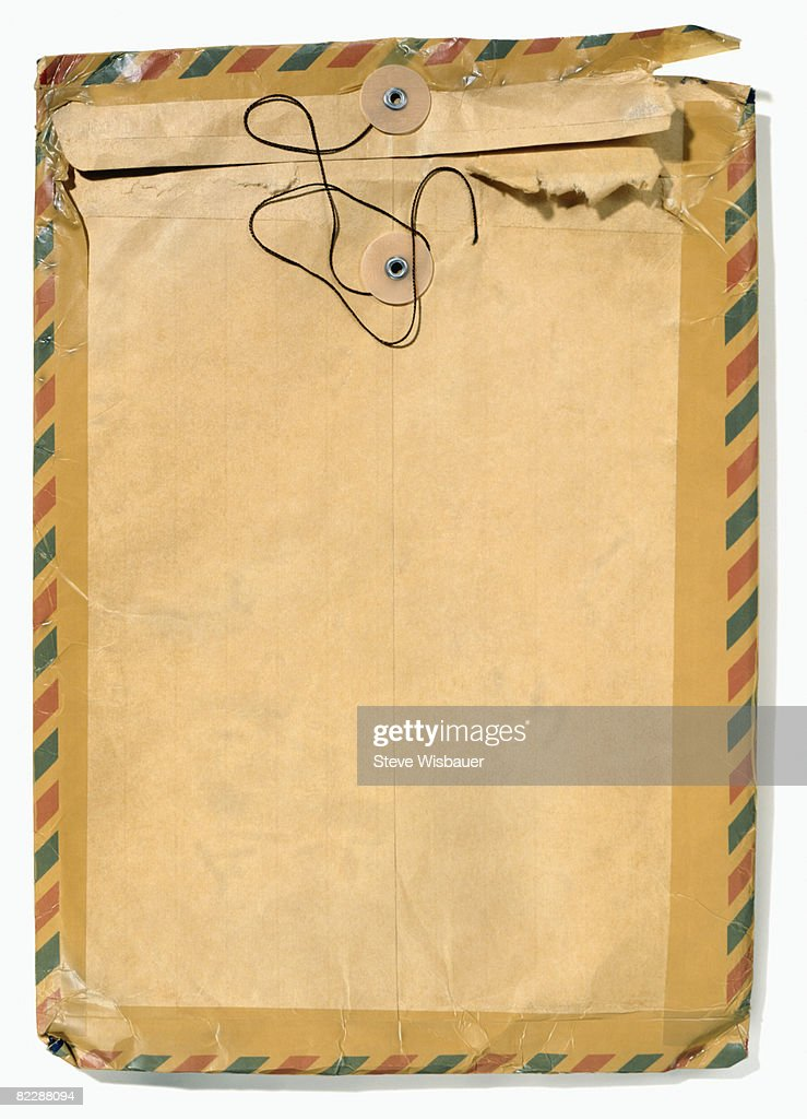 Old manila envelope with airmail tape : Stockfoto