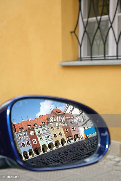 Old market buildings reflected in a car wing mirror, Poznan, Poland