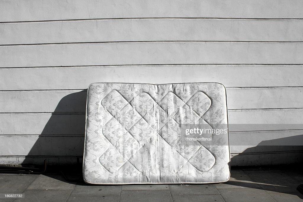 Old mattress on street