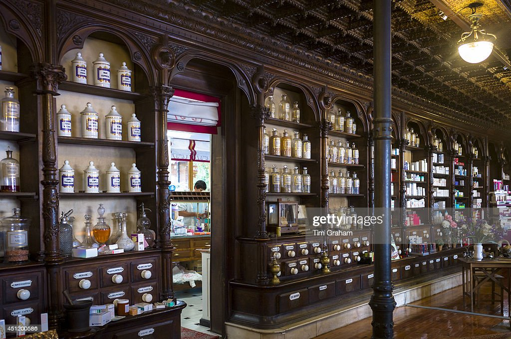 Old medicine bottles pharmacy display in Farmacia Dr A Alonso Nunez pharmacy shop in Calle Ancha Leon Castilla y Leon Spain