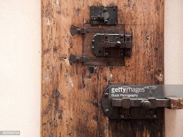 Old medieval iron locks on the front door of a building in Florence, italy
