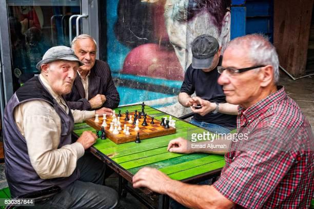 Old men playing chess in the street, Kutaisi, Georgia - June 27, 2017