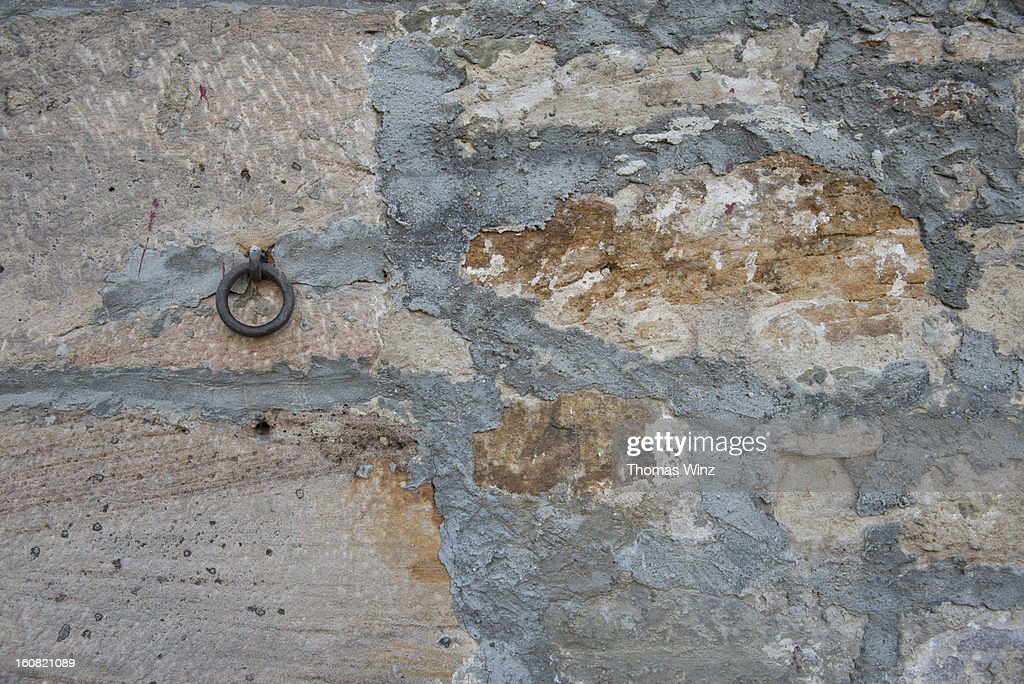 Old metal ring mounted on a wall : Stock Photo
