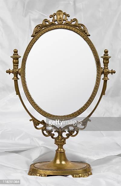 Old mirror on satin
