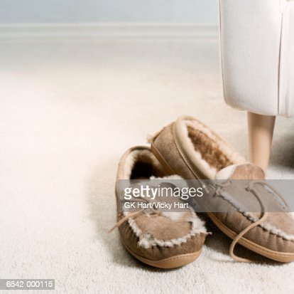 Old Moccasin Slippers by Sofa