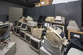 Old monitors and computer parts in office