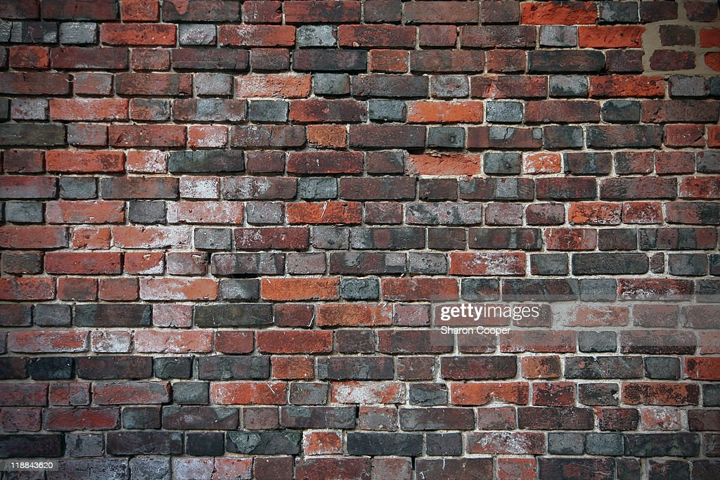 old multi coloured weathered brick wall : Stock Photo