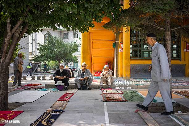 Old Musilm sit at Xining Dongguan Mosque on August 1 2014 in Xining China Xining is the main Muslim city in northwest China