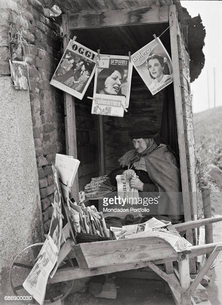 Old newsvendor This picture is taken from the monography 'Mario De Biasi Il mio sogno Š qui' curated by Enrica Vigan• published in 2016 by Mondadori...