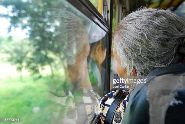Old Nicaraguan woman riding a bus
